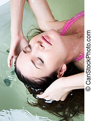 Washing - Image of serene woman with closed eyes having...
