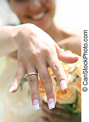 Newlywed - Close-up of brides hand with posh wedding ring...