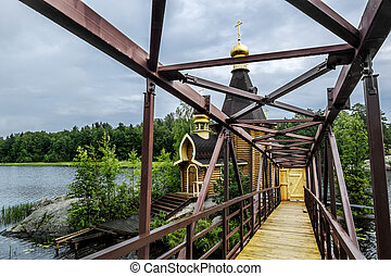 View of the Church of St. Andrew on the island on the lake...