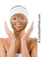 Facial care - Beautiful woman with purifying facial mask...