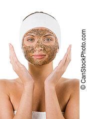 Facial care - Beautiful woman with purifying facial mask...