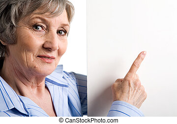 Announcement - Image of elderly female pointing at blank...