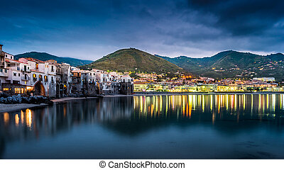 View on habour and old houses in Cefalu at night, Sicily...