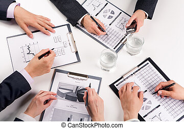 Work in group - Above view of business people working with...