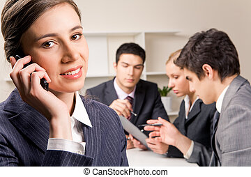 Business call - Photo of female employee speaking on the...
