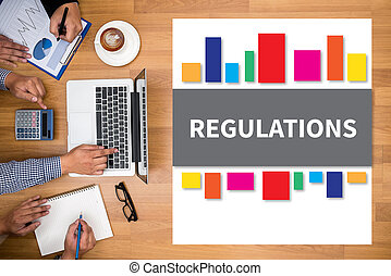 REGULATIONS Business team hands at work with financial...