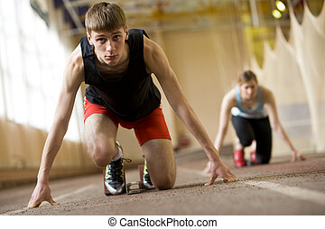 Runner - Image of serious young man ready to start running...