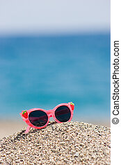 Pink sunglasses - Image of pink glamorous sunglasses on pile...