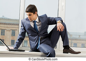 Office work - Photo of smart businessman sitting on...