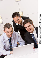 Brainstorming - Portrait of executive employees looking at...