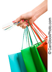 Purchasing - Photo of hand holding shopping bags and three...