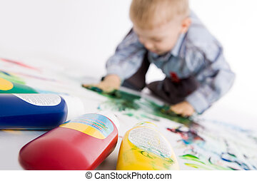 Gouache - Photo of colorful gouache with painting kid at...