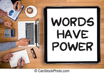 Words Have Power Business team hands at work with financial...