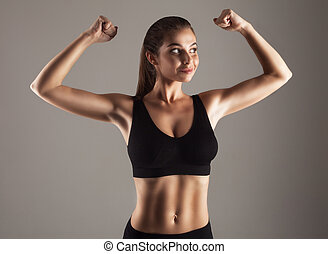 Model doing strength training - Young attractive model doing...