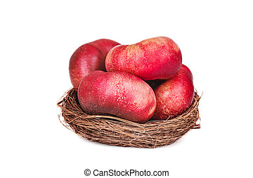 a basket of flat nectarines on white backgraund