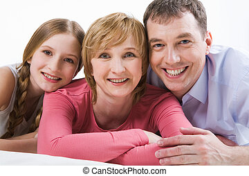Parents and daughter - Portrait of happy mom, dad and their...