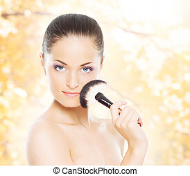 Portrait of a woman in makeup on an autumn background -...