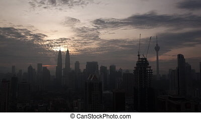 Time lapse panoramic view of constructed modern city Kuala...