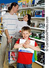 Happy shopper - Portrait of joyful lad holding box in hands...