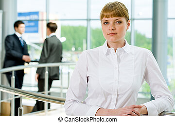 White collar worker - Portrait of attractive female looking...