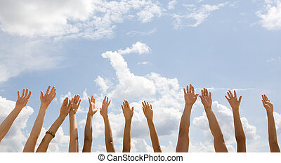 Row of hands - Row of several human hands isolated on a sky...