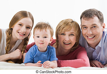 Family members - Portrait of joyful mom, dad and their...
