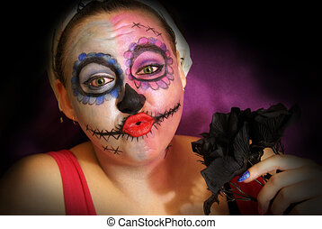 Skull Candy Woman - A woman in skull candy makeup for day of...