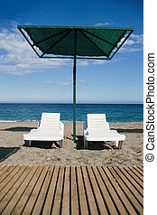 Restful place - Photo of two deck-chairs with umbrella near...