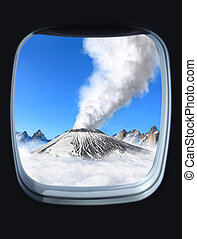 volcano - volcanic eruption view from the window of plane