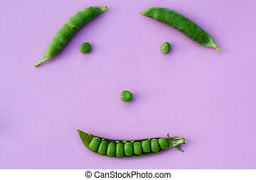 peas - smile of a few pods of ripe green peas