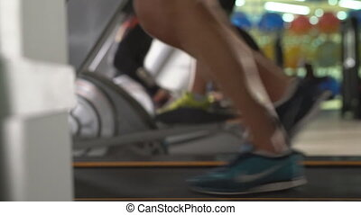 View of man running on treadmill, close-up