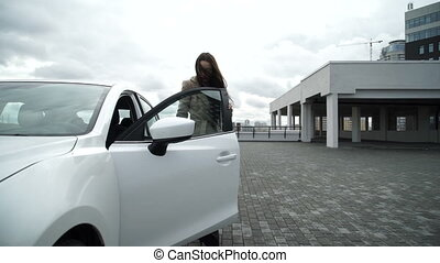 Girl out of the car - Girl gets out from car and goes to...