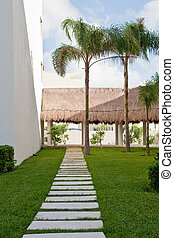 Stone Paver Walkway Through Tropical Lawn