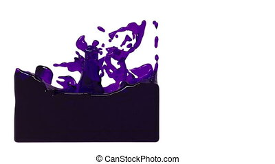 turbulent pink liquid filling a container. dyed oil -...