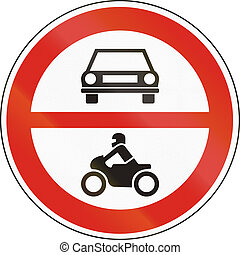 Road sign used in Hungary - No motor-driven vehicles.