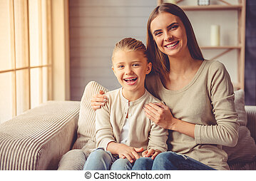 Mother and daughter at home - Portrait of beautiful young...