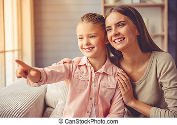 Mother and daughter at home - Beautiful young mother and her...