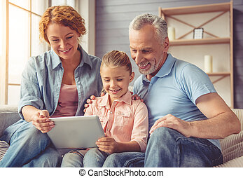 Grandparents and little girl at home - Beautiful happy...