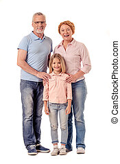 Grandparents and little girl - Full length portrait of...