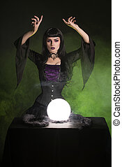 Beautiful fortune teller wearing gothic style outfit,...