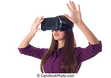 Woman using VR glasses - Young attractive woman in purple...