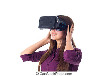 Woman using VR glasses - Young smiling woman in purple...