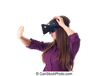 Woman using VR glasses - Young woman in purple blouse with...