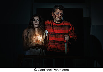 Man and a woman at Halloween.