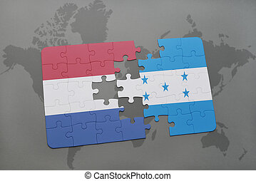 puzzle with the national flag of netherlands and honduras on...