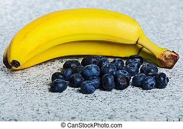 Two bananas and heap of huckleberries.