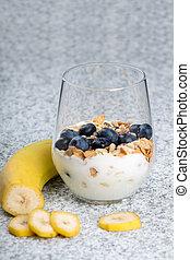 Dietetic breakfast - yoghurt with mueasli and huckleberries...