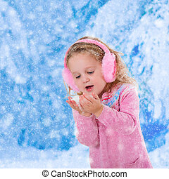 Little girl catching snow flakes - Little girl in pink...