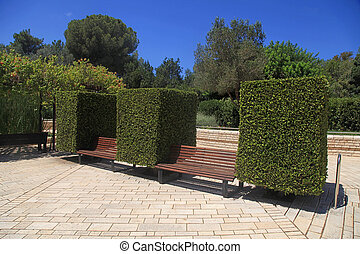Garden bench between boxwoods in Park Ramat Hanadiv, Zichron...