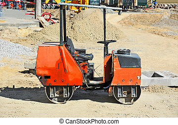 Red asphalt paver - Asphalt paver on road construction site